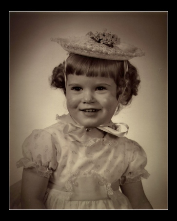 Dressed in my Easter Sunday dress and bonnet, I was a happy toddler in this portrait taken by my father.