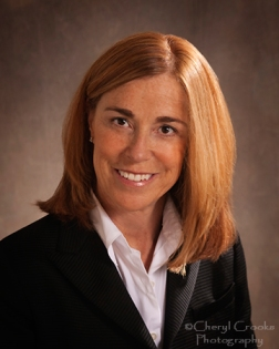 Carolyn Coughlin chose a black suit for her website portrait.