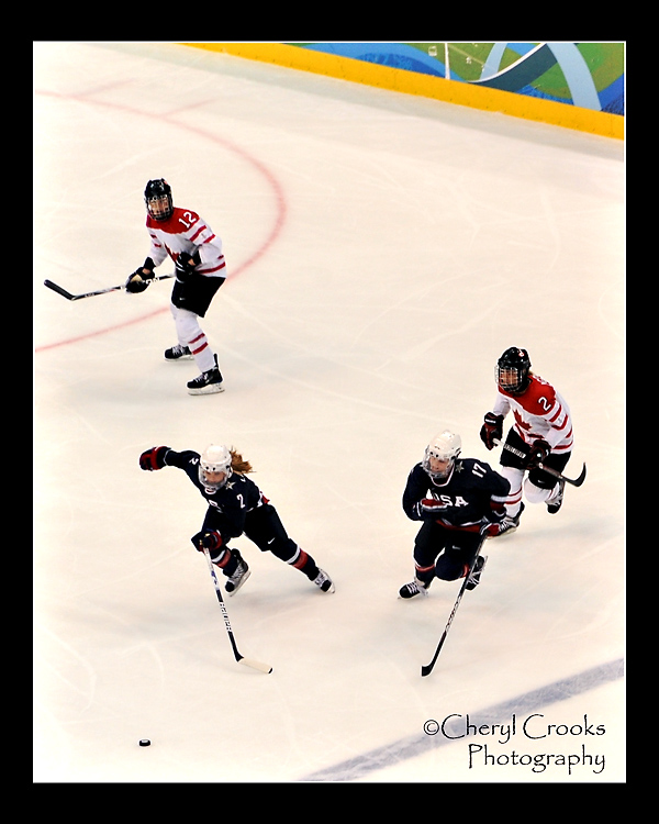 The fight for the puck during the gold medal game between the American and Canadian women's hockey teams was constant and competitive.