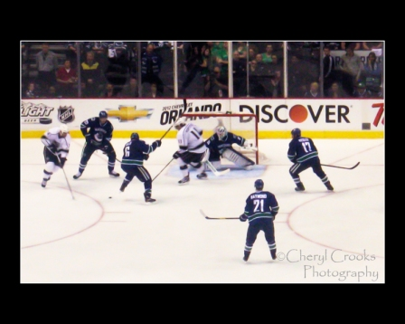 The Los Angeles Kings try to slip on in during a play-off game last year against the Vancouver Canucks.