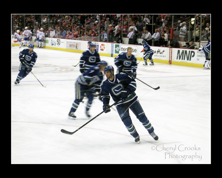 Vancouver Canucks center Ryan Kesler warms up with his teammates.