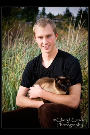 His cat wasn't excited about posing for the portrait, even though Logan held it securely in his arms.