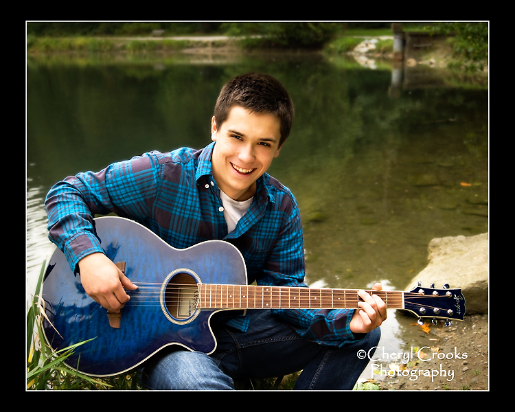 Marcus loved music and brought his blue guitar with him to his senior portrait session in Whatcom Falls Park