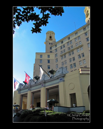 Flags fly over the entrance that  welcomes guests to the Arlington Hotel.