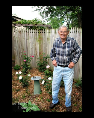 Gardening has always been one of my Dad's joys.  He's shown here with his rose bushes.