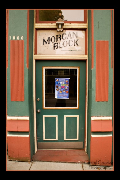 Entry to the upstairs rooms of the historic Morgan Block building is through the green door at the street level.