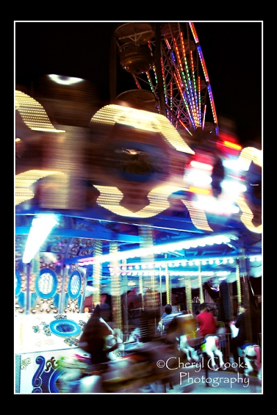 I love the colors of the carousel that blur together as horses and riders go round.