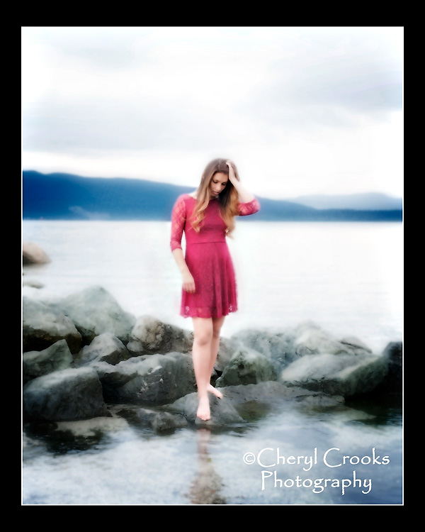 The dress, the long hair, the water, the rocks, the sky. the stance all lent to create a sense of romance in this senior portrait of Maya.