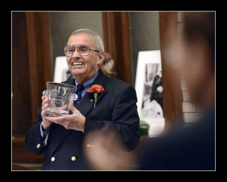 Photographer Ben Martin holds the Clement Cup during a standing ovation at the award ceremony by the Andrew Jackson in Salisbury, N.C. where he now lives. Martin was honored for his contributions to the Historic Salisbury Foundation.  Photo by  by Wayen Hinshaw for The Salisbury Post.
