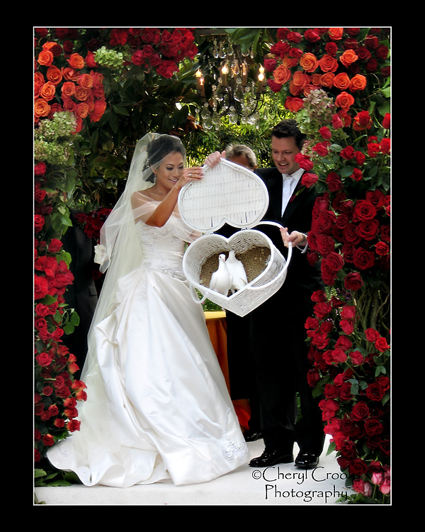As a wedding photographer, you must be ready for anything, including a pair of doves about to take flight.