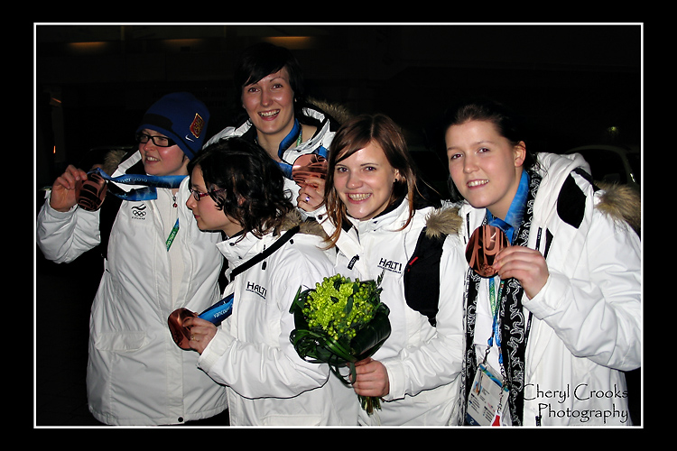 Returning from the gold medal women's hockey game, I ran into members of the women's hockey from Finland who had just picked up their bronze medal. They were more than happy to stop for photo and to show off their hard-won prize.