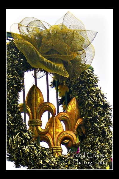 Elaborate wreaths such as this Fleur de Lis hang from the balconies in the French Quarter during the Mardi Gras season.