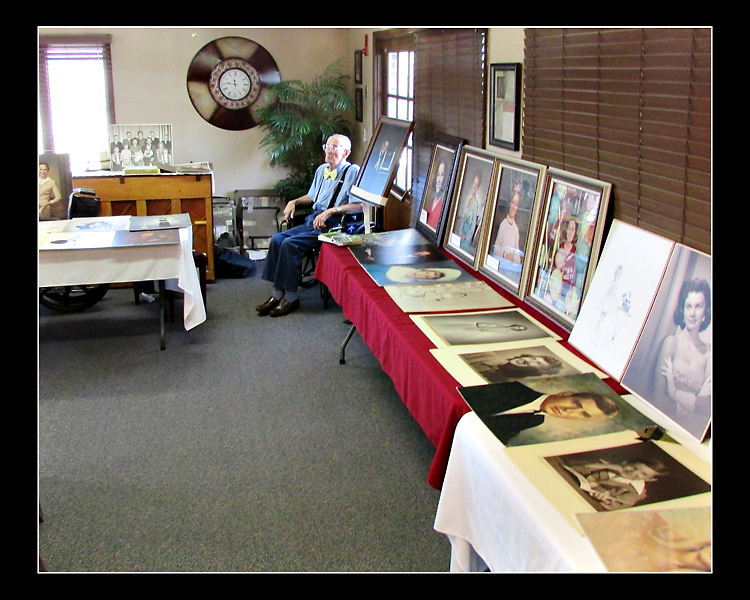 In March, my Dad, shown here, displayed his collection of studio sample and competition prints in one final showing.