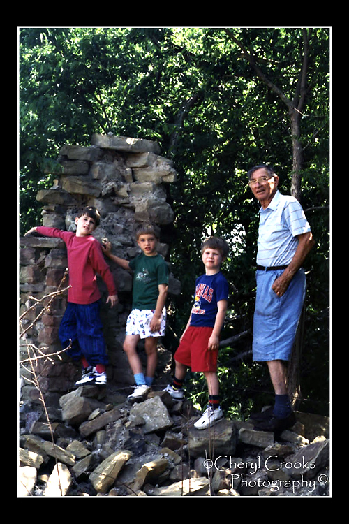Another photo from one of my parents' albums recalls a visit with his three grandsons to the place where he had grown up. There wasn't anything left of his childhood farmhouse except part of the home's rock wall. But we have it now preserved in this precious photograph.