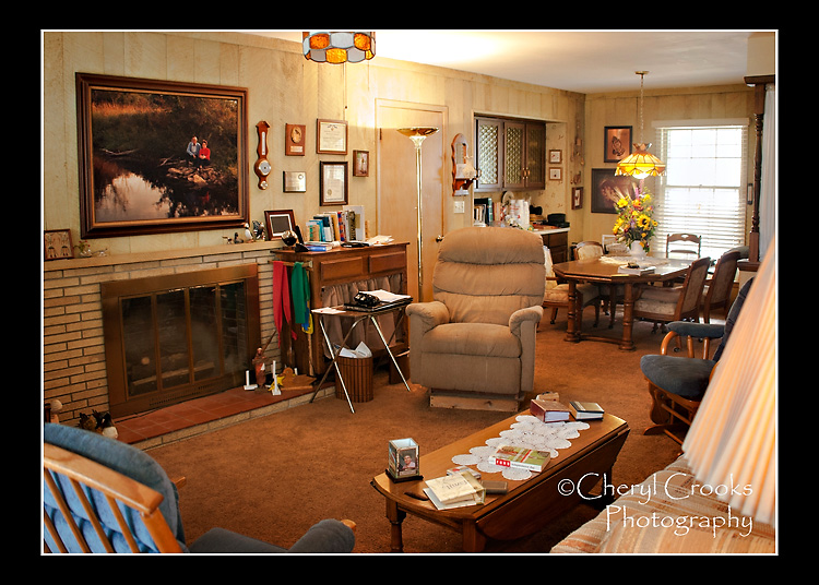 A large canvas portrait, taken by my brother,  Brad, hung above the fireplace and was the centerpiece of the family room.