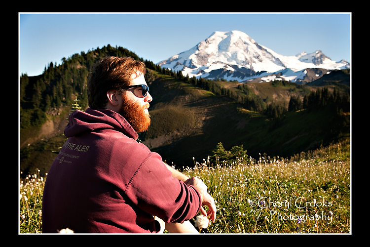 The snow-capped summit of Mount Baker is the prominent peak  on the Skyline Divide and makes a breath-taking  backdrop for my son's picture.