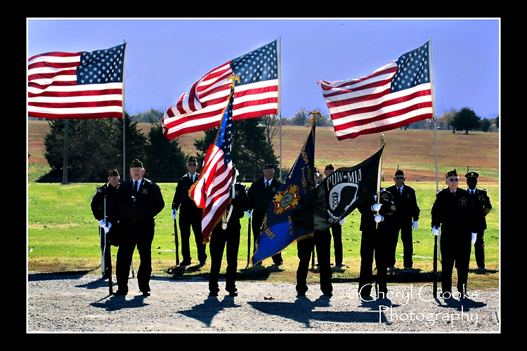 The Parsons VFW color guard prepares to give the 21-gun salute during the Veterans Day program.