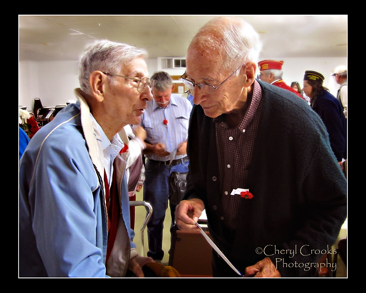 Longtime friends as well as World War II veterans, my Dad talks with Pete after the VFW ceremony in 2013. Our World War II vets are vanishing at a rapid rate.
