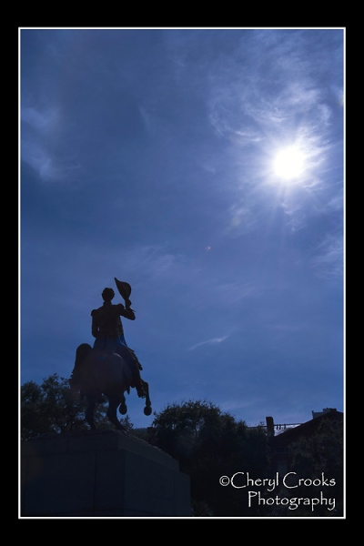 The statue of Andrew Jackson upon his horse is silhouetted in New Orleans' Jackson Square.