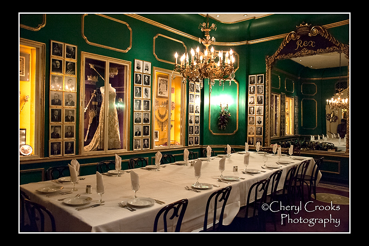 Mardi Gras memorabilia and ball gowns are displayed in Antoine's Rex Room where the banquet table is set for a krewe luncheon or dinner.