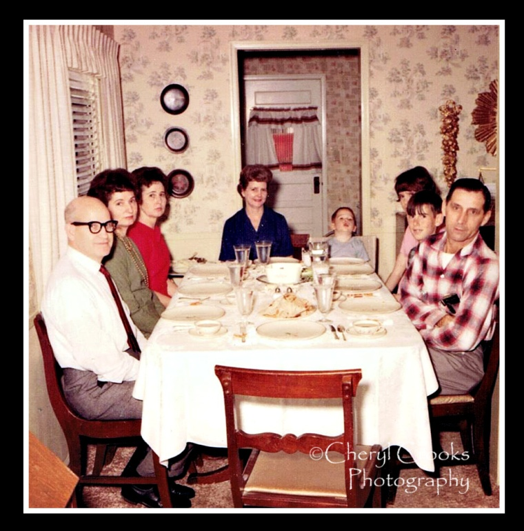 With my aunts and uncles, my family sit down together for a Sunday dinner.