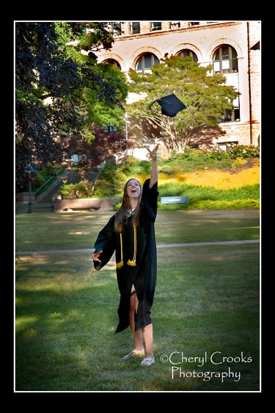 In the traditional manner, Megan gives hers graduation cap the celebratory toss!