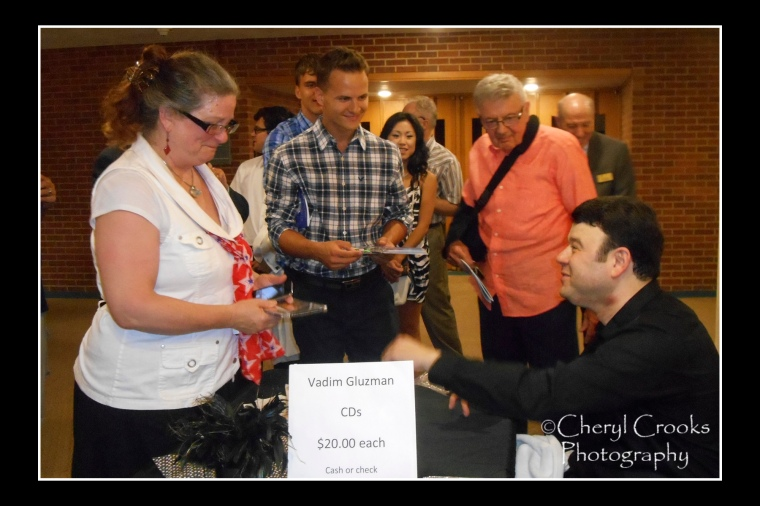 Violinist Vadim Gluzman greets fans and sign autographs following hisperformance at the 2015 opening night concert Bellingham Festival of Music