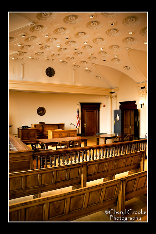 Your eyes gaze upwards to the decorative coffered ceiling.