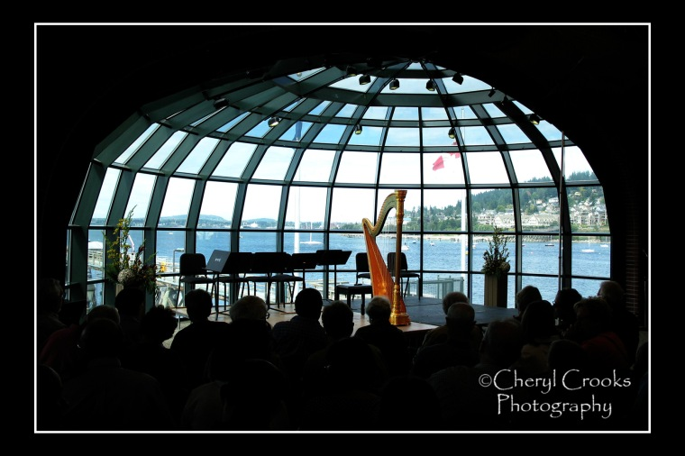 Audience members await the start of the chamber music concert staged in Bellingham's Ferry Terminal each year with stunning views of the bay and the city.