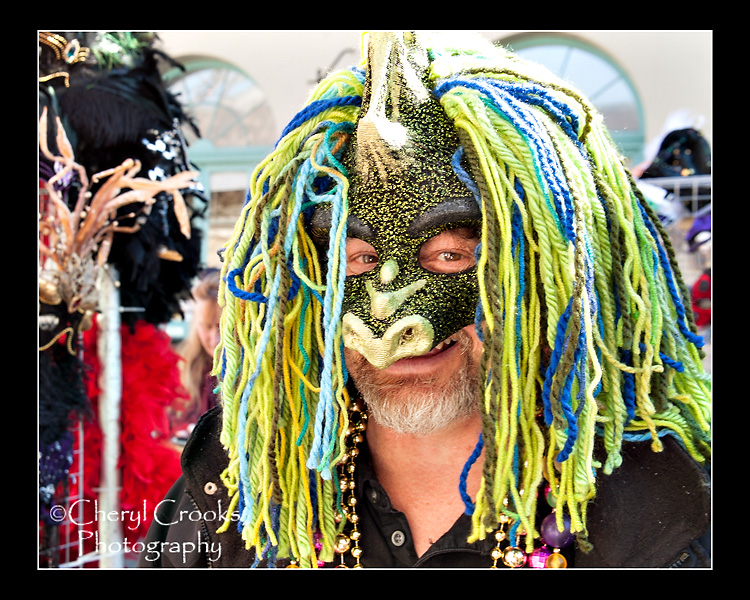 Colorful strands of yarn are decorate the masks of Connie Trapp.