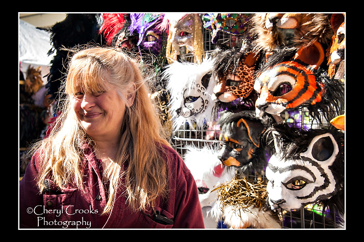 Diane Trapp with some of ther masks shown at the 2016 Mask Market in New Orleans.