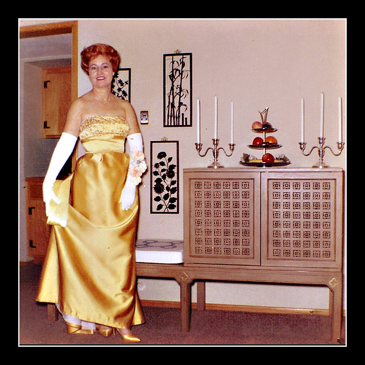 My aunt poses for a photo in her golden gown before heading out for a big night.