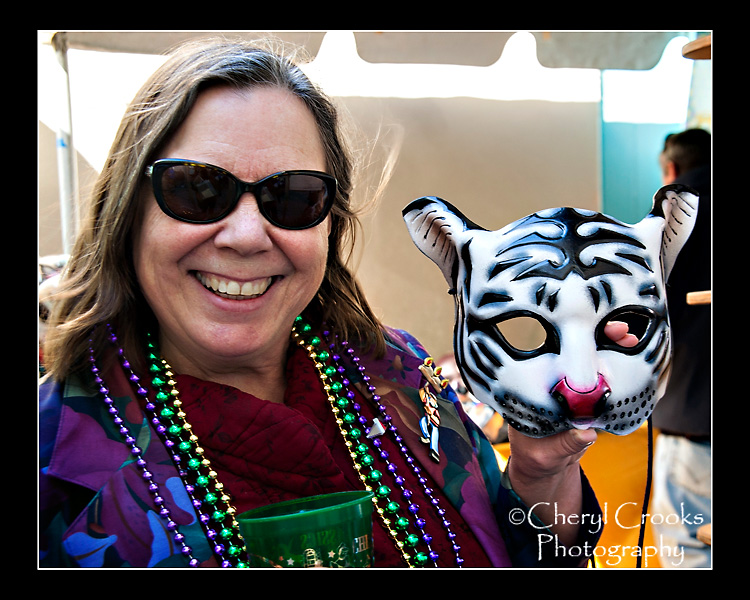 The cat mask shown here by his assistant, was Richard Thompson's new design at this year's Mardi Gras Mask Market.