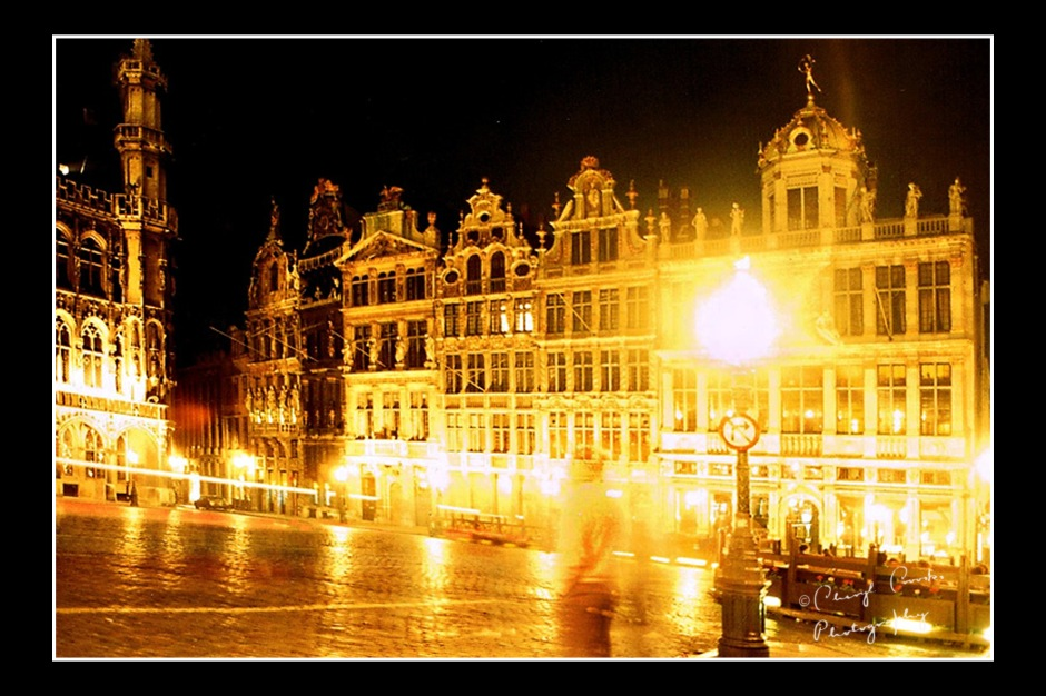 The Guild Houses lining Brussel's Grand Place gleam in the night lights.