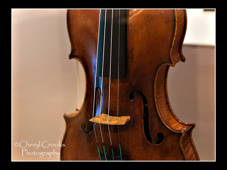 A detail of the Stradivari violin on exhibit at MIM shows the close grain of the wood. A detail of the Stradivari violin on exhibit at MIM shows the close grain of the wood.