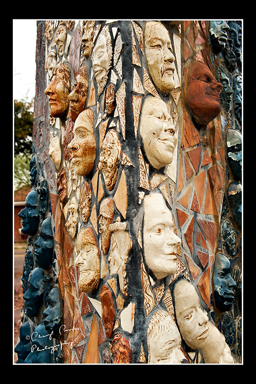 The three-sided artwork is filled with faces from the Phoenix community.