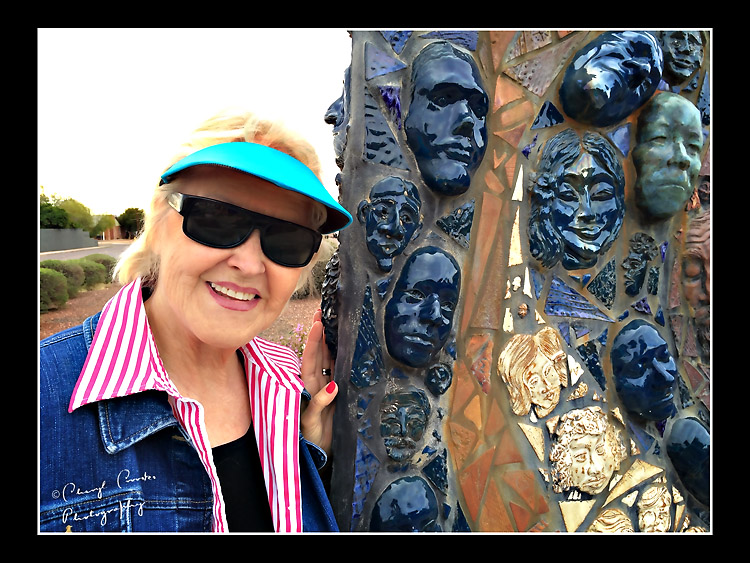 My friend Eileen's face is among the many on the sculpture.