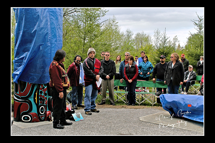 Family members of two of the boys killed by the Olympic Pipeline explosion in Bellingham gather with Lummi Naton members for the unveiling of the 'healing' totem, carved and dedicated by the Lummi Nation in 2007.