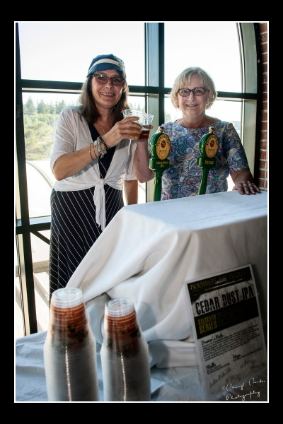Janet Lightner,co-owner of Boundary Bay Brewery, served brews with her sister, Vicki, at the Festival of Music picnic.