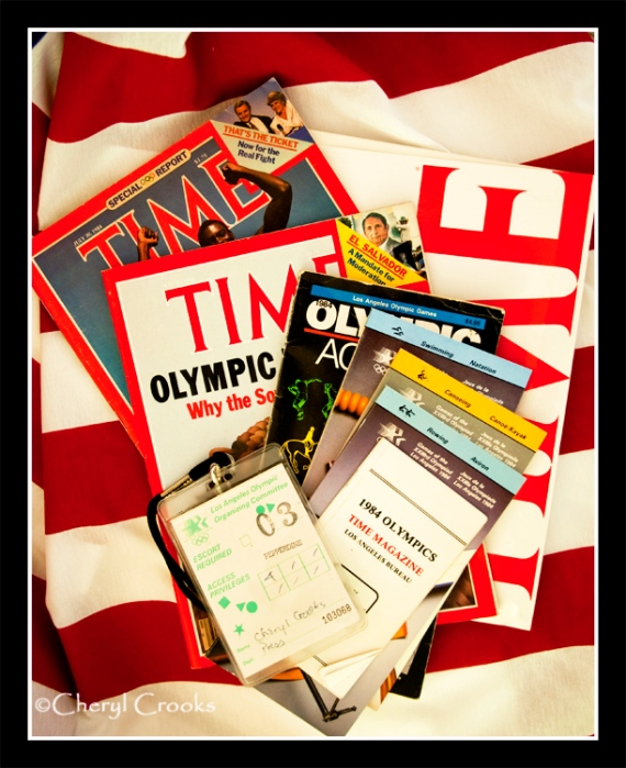 Press pass, contact book, guides, maps along with copies of TIME's Olympics issues from 1984.