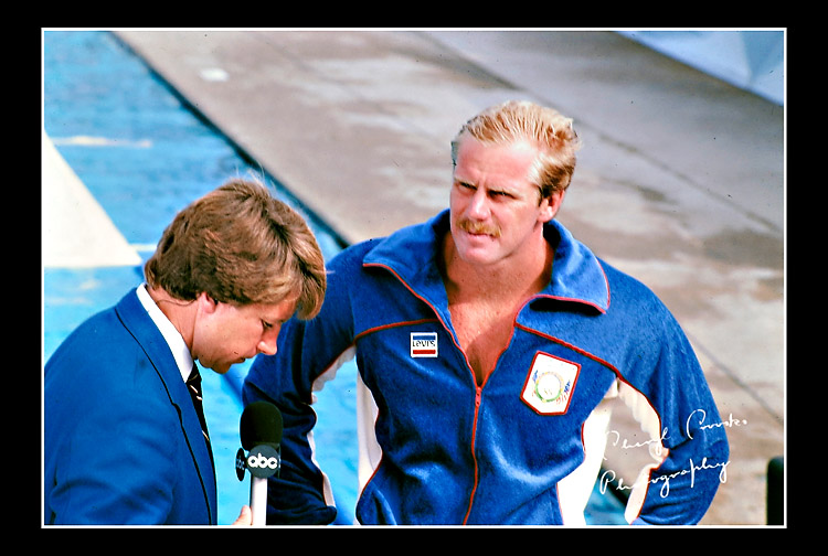 USA player Terry Schroeder is interviewed poolside by a member of the television media at the 1984 Olympic games.