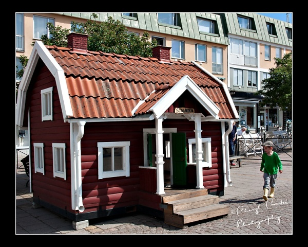 Play strutures like this child-size cottage sit in Vimmerby's town square for children to explore.