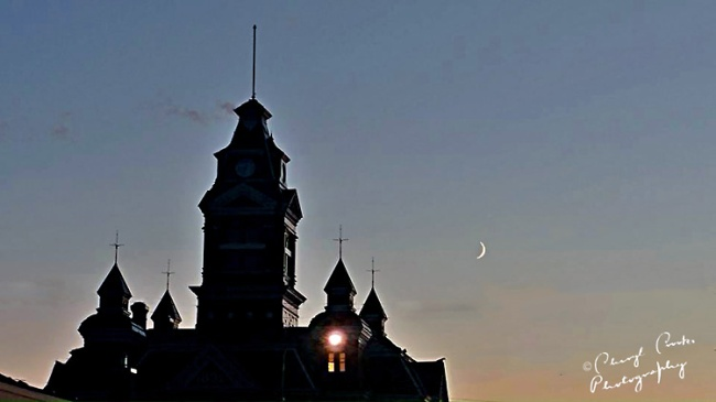 Walking out of the museum one evening, the silhouette of the old City Hall's towers with the new moon just appearing behind it caught my eye and my camera. This was taken with my Nikon Coolpix S3500 point and shoot.