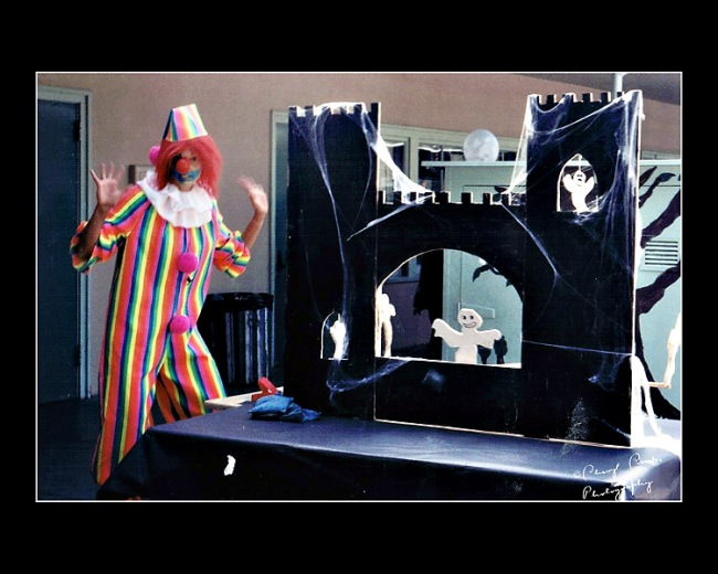 My friend, Pam, dressed as a 'friendly' clown and staffed the ghost castle game at the Calahan School Halloween Festival.