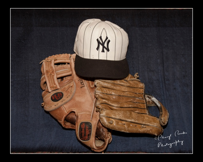 My ball gloves and Yankee cap wait for a day of baseball.
