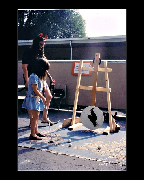 Parents staffed the games at the school's Halloween Festival while the kids tested their skills.