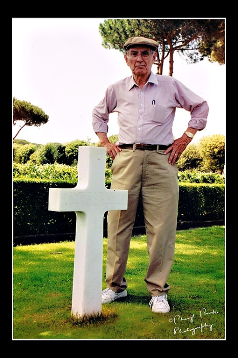 My Dad stands beside one of the graves of the thousands buried at the American cemetery in Anzio.
