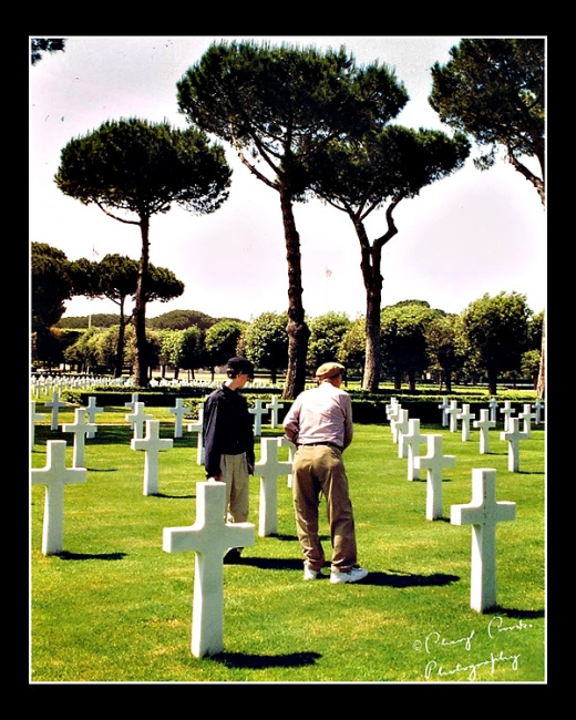 My son and my Dad share a quiet moment together in the cemetery at Anzio.