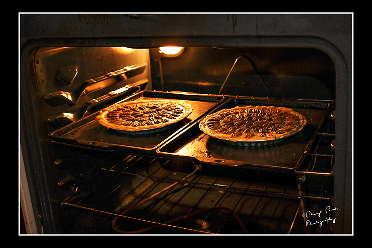 My Dad's pecan pies sit ready to bake in the hot oven. Each one was made with love.