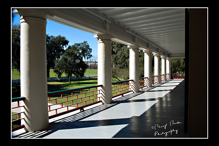 The open gallery on the front of Detrehan looks toward the Mississippi River and provided shade during the hot Louisiana summers.